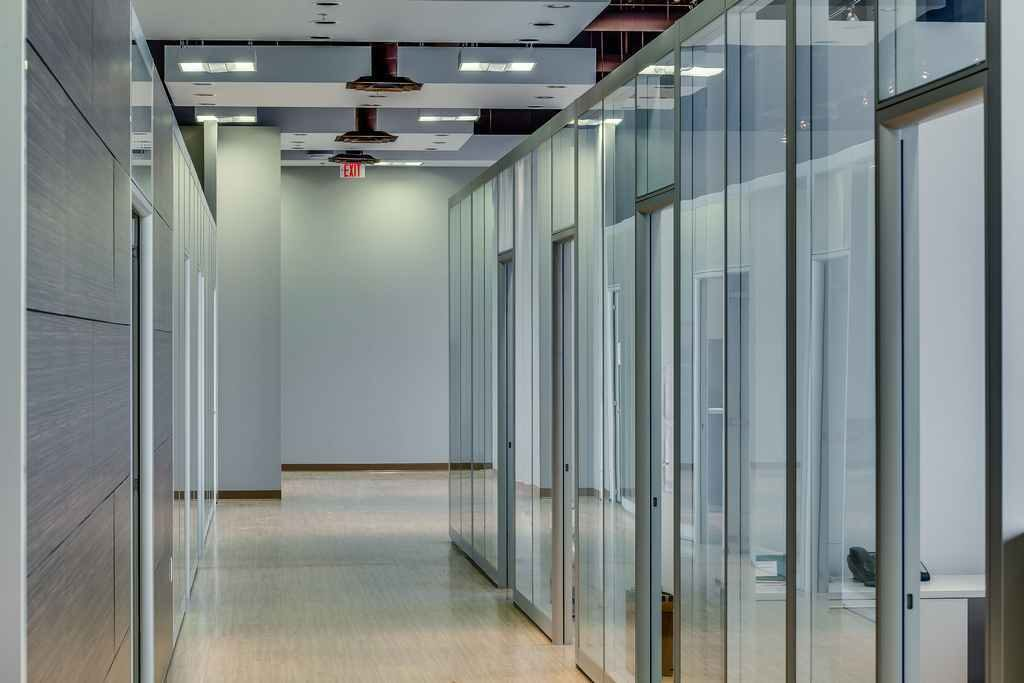 infusing office energy with glass partition walls
